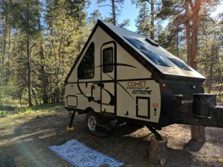 A-frame pop-up camper in the woods